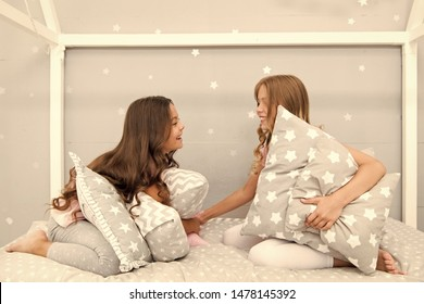 Pillow fight pajama party. Sleepover time for pillow fight. Girls sleepover party ideas. Soulmates girls having fun sleepover party. Girls happy best friends in pajamas with pillows sleepover party.