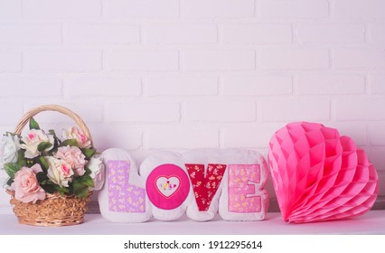 pillow in the form of the word love on a white background . concept of romance,  Valentine's Day, Mothers Womans Day
