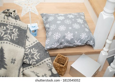 Pillow with New Year's pattern in the room decorated for Xmas - white and gray