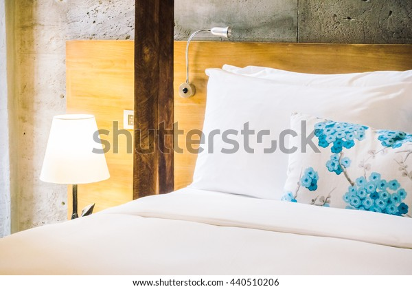 Pillow on bed decoration in beautiful bedroom interior - Vintage light Filter