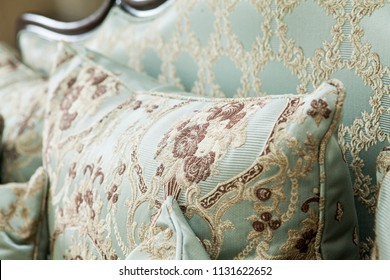 Pillow on the classic couch, baroque, rococo, vintage. Luxurious classical furniture background.