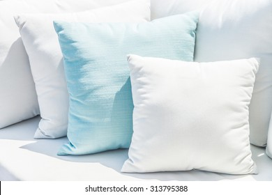 Pillow on sofa bed with outdoor view