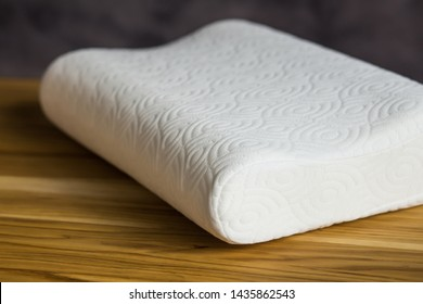 pillow, orthopedic, on a wooden table