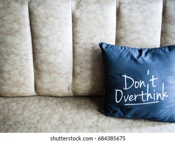 Pillow quotes 'don't over think' on sofa