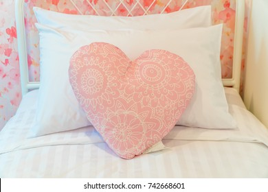 Pillow red heart or love shape on sofa.