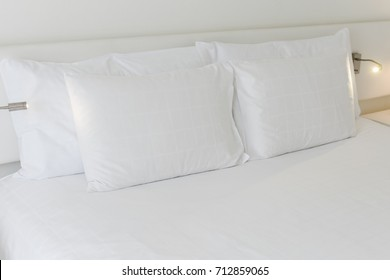 Pillows and bed sheets in beauty room
