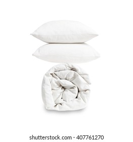 Pillows and duvet on white background