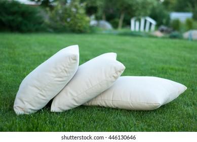 Pillows on the green grass