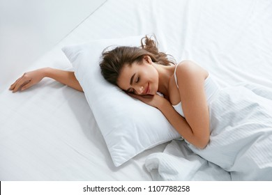 Pillows. Woman Resting On White Pillow Sleeping In Bed