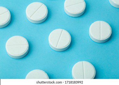 Pills background. Pills, drags and medecine concept. White tablets on a blue background