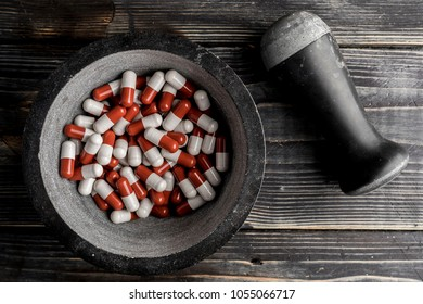 pills in the bowl on wood background. pills addiction concept