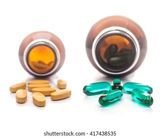 Pills capsule spilling out of a bottle, Medicine capsule for health