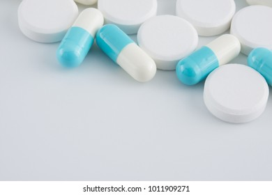 pills and capsules of medicine on white background