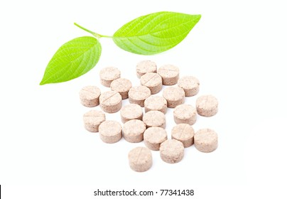 Pills with green leaf isolated on a white background. Herbal Medicine.