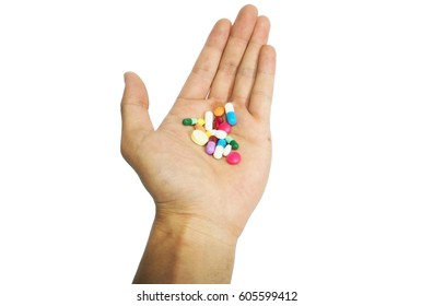 Pills in hand on white background