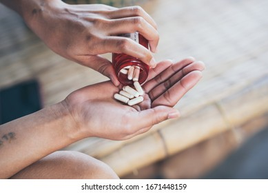 Pills and medicine in woman hands, Hazardous drugs have adverse effects on health.