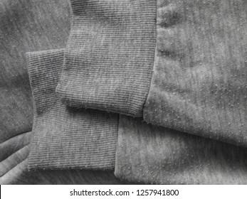 Pills on the heather gray sweatshirt cotton knit fabric. Bobbles on the knitwear.