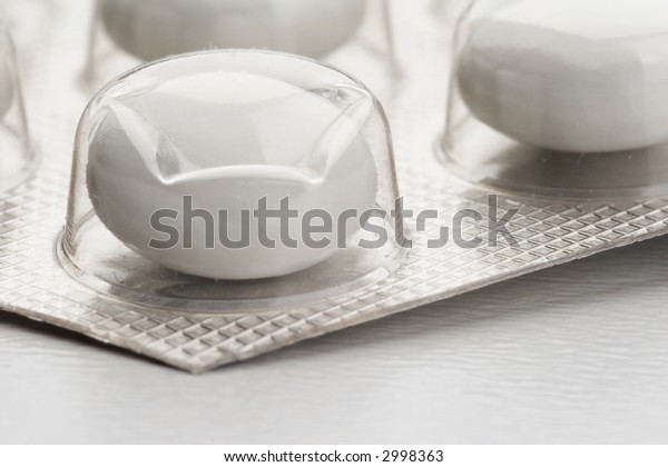 Pills and Package on white background