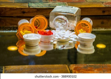 pills prescription drugs spill on counter open pill bottles ready for medicine and healthcare Gel Caps and Pain Killers tablets