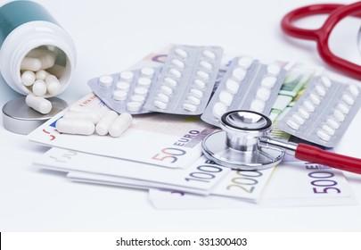 Pills stethoscope and money