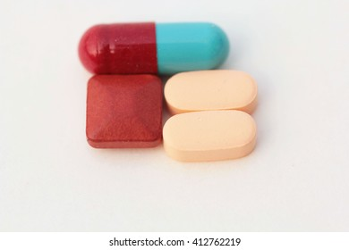pills and tablets on a white background