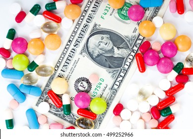 Pills and tablets on white background with dollar bill in vivid colors horizontal