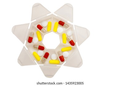 Pills and tablets are sorted for a week in a plastic box