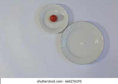 Pills vs vegetables and fruits: tomato vs white pill