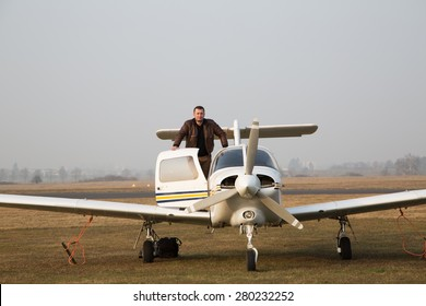 Pilot with the aircraft  after landing.