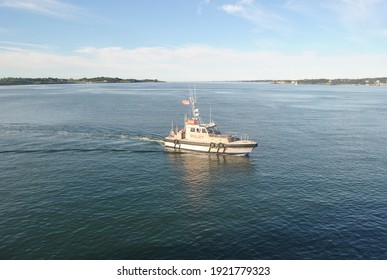 The pilot boat come near to the cruise ship and lower the life boat for tendering at Bar habor. Bar Harbor maine,USA September 16,2010.