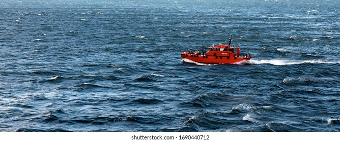 Pilot boat crashing through the waves in Copenhagen, Denmark
