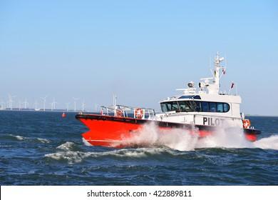 Pilot boat crashing through the waves in Vlissingen, the Nethertlands