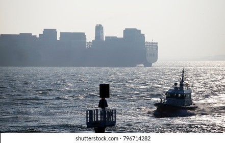 A pilot boat and a large container ship, Vlissingen, The Netherlands