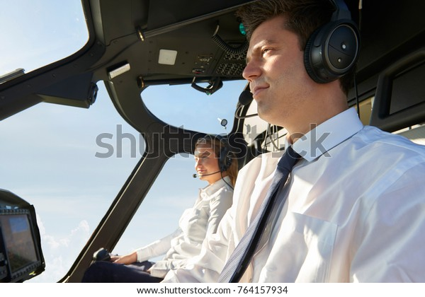 Pilot And Co Pilot In Cockpit Of Helicopter