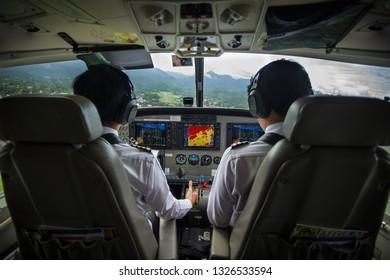 Pilot in cockpit before landing