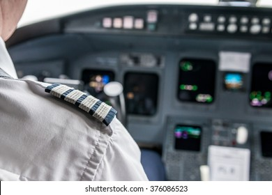 Pilot in cockpit flying