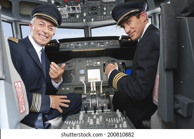 Pilot and co-pilot piloting airplane from airplane cockpit