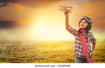 pilot girl playing outdoors with plane