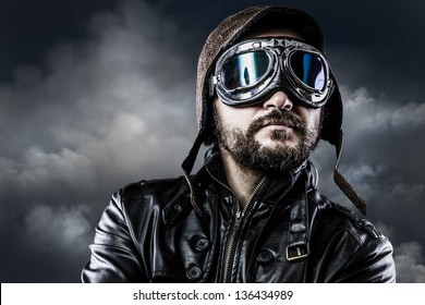 pilot with glasses and vintage hat with proud expression