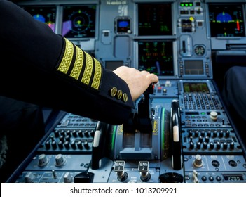 A Pilot hand is controlling plane to fly take off and landing