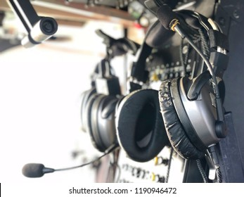 Pilot headset on the wall or Pilot headphones. Headphones for pilots. Aviation headphones for pilots or radio headphone for flight crew