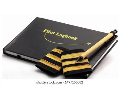 Pilot logbook with 3 gold pilot bars