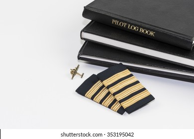Pilot logbook with 4 gold Captain bars.