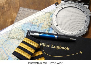 pilot logbook with map and E6B calculator