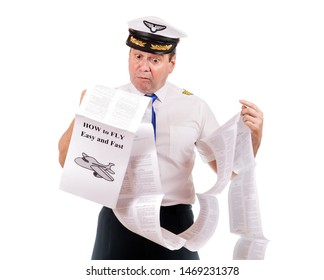 The pilot looks into instructions about using the aircraft, isolated on white background. Aircraft captain is studying a manual about flying.