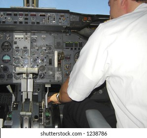 Pilot operating an airplane - inside boeing 737 cockpit