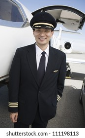 Pilot with plane in the background