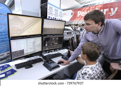 Pilot of a plane teaches an intern to practice on a flight simulator. Demonstration for mass media. Airport of Boryspil. June 12, 2017. Kyiv, Ukraine