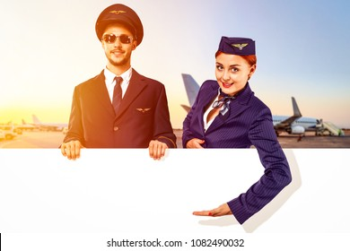the pilot and stewardess hold an advertising banner