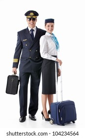 The pilot and stewardess with a suitcase on a white background